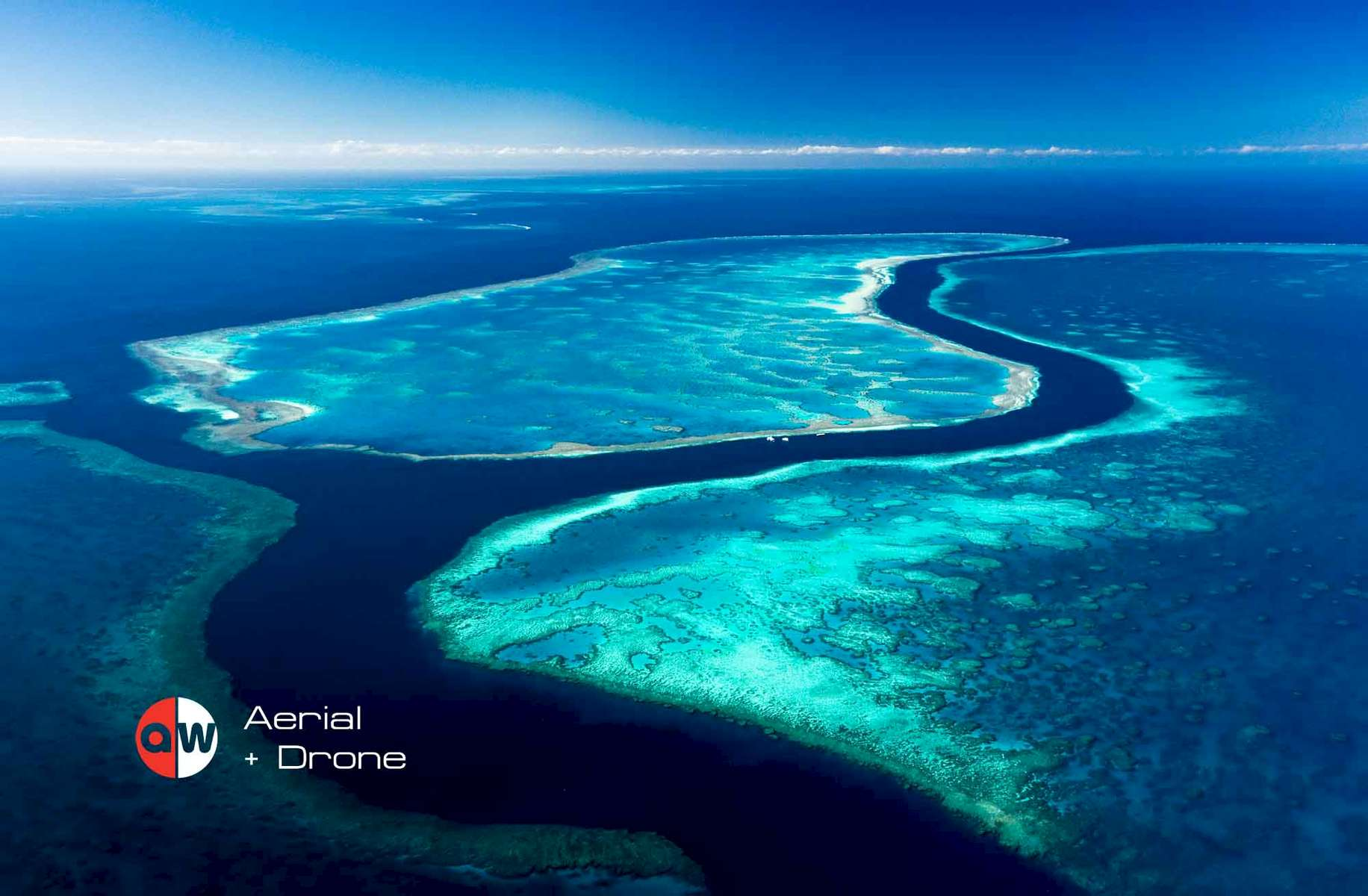 Aerial view of channel running through Hardys, Hook and Line Reef in the Great Barrier Reef, Whitsundays
