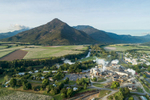 Aerial view of sugar mill with Walsh's Pyramid beyond, Cairns