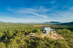Aerial view of remote residential home atop hill at Walsh River,  Atherton Tablelands