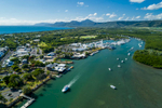 Aerial view of boat leaving Port Douglas harbour with Dickson Inlet beyond