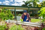 A female aged care resident enjoying some time gardening