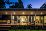 Residential home patio illuminated at twilight, Cairns