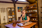 Portrait of female business owner in wood working craft shop, Tolga