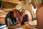 Young women laughing and enjoying a glass of wine in a Barossa Valley winery