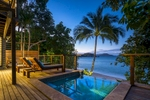 Pool deck of beach villa overlooking the sea at twilight, Bedarra Island Resort