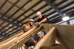 A construction supervisor instructing a student at a building, Cairns