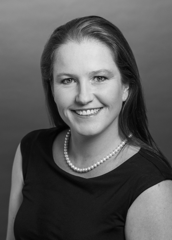 Black and white head shot of a female staff member in real estate business, Cairns