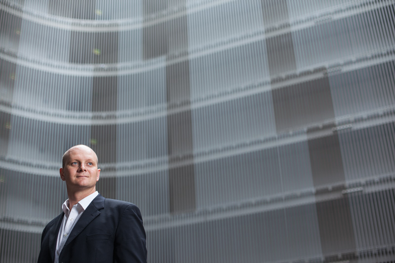 Portrait of businessman with architectural background