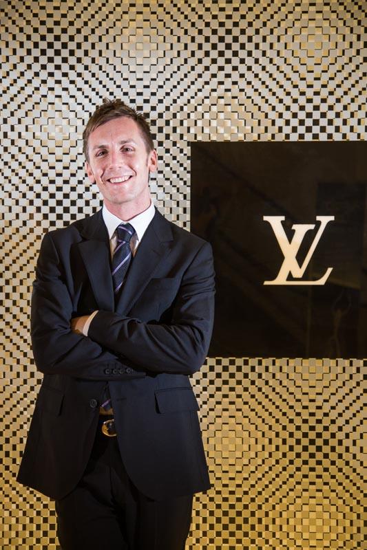 Portrait of business executive outside of Louis Vuitton store, Cairns