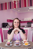 Profile photo of business owner in cupcake store, Cairns