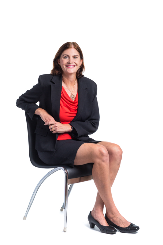 Full length portrait of female real estate agent against white background, Cairns