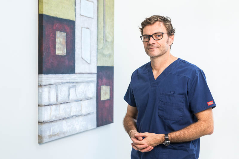 Portrait of male doctor with medical centre background in Cairns