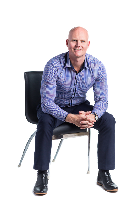 Full length portrait of male real estate agent against white background, Cairns