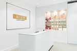 The front counter and product shelves in the Silk Laser Clinic Cairns