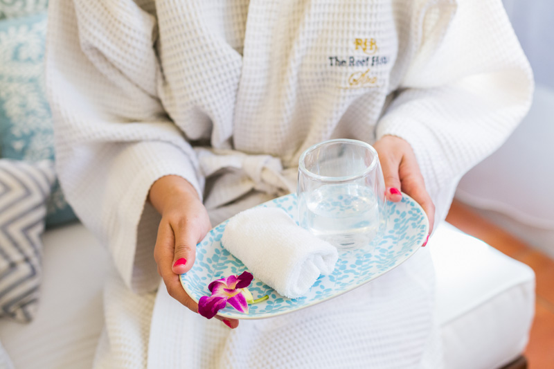 Customer holding refreshment towel during Spa treatment at The Reef House Palm Cove