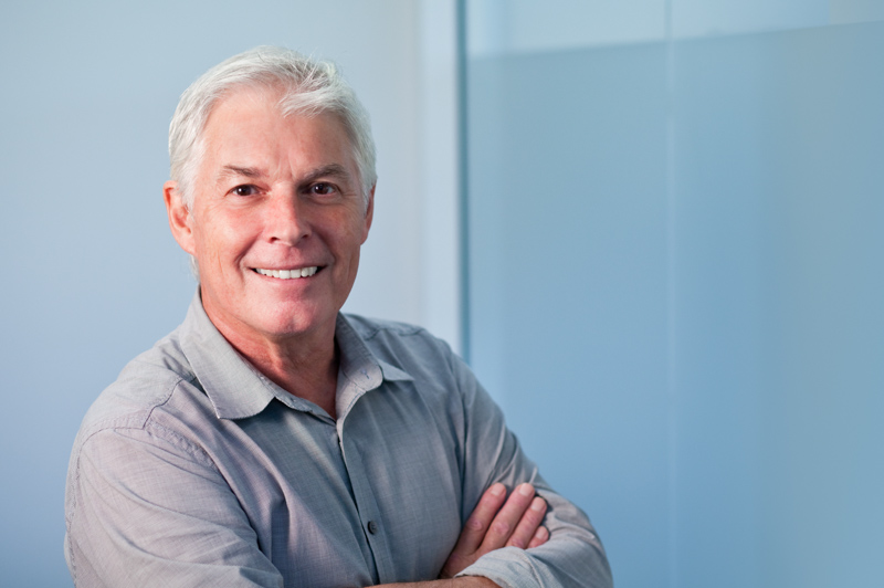 Business headshot of male architect with office background, Cairns