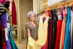 Portrait of business owner holding dress at Dada's Step in Oceana Walk Arcade, Cairns