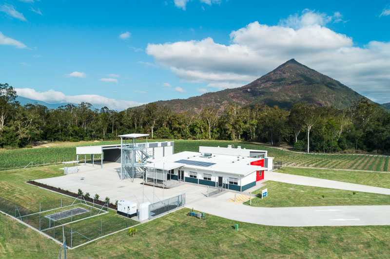 Aerial view of the Gordonvale Fire and Rescue Station with Walsh's Pyramid beyond, Cairns
