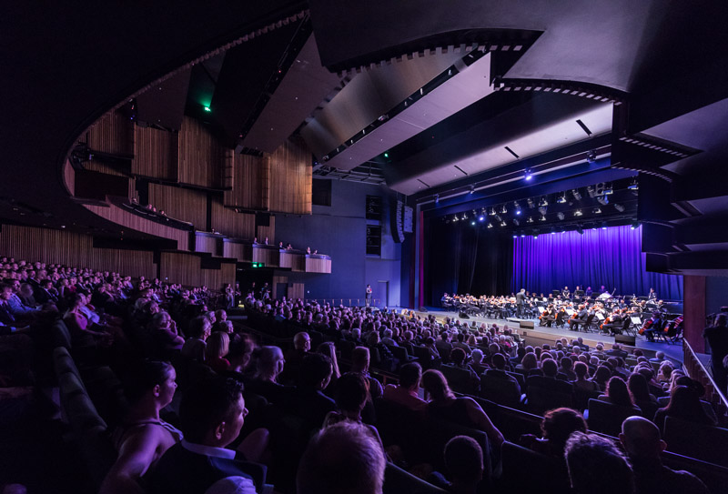 People watching a musical performance onstage at the Cairns Performing Arts Centre