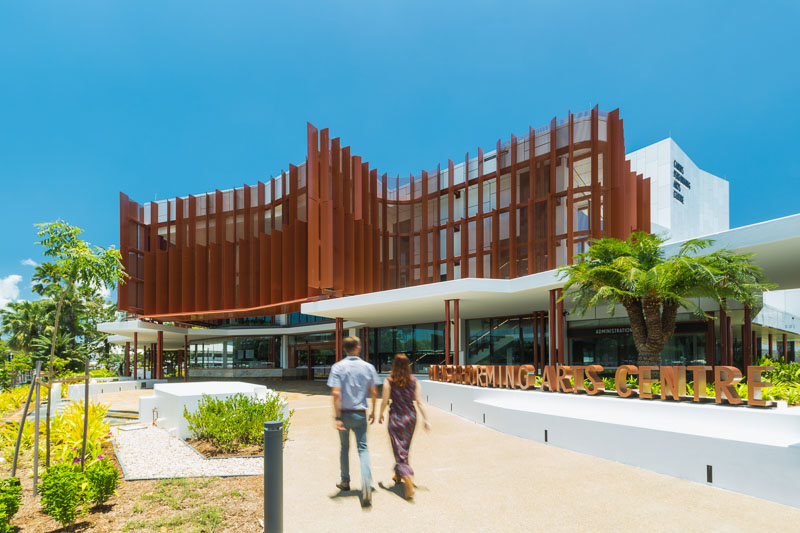 Couple walking towards entrance of the Cairns Performing Arts Centre
