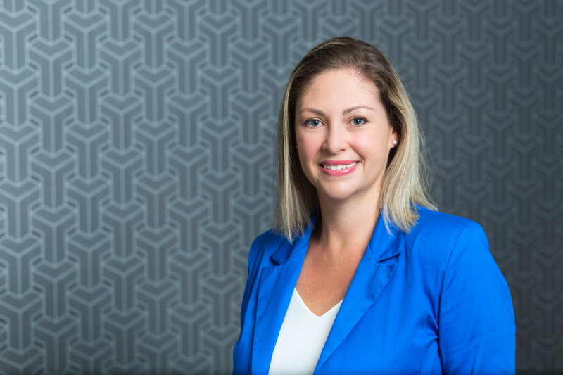 Headshot for female construction company administrator with patterned background, Cairns