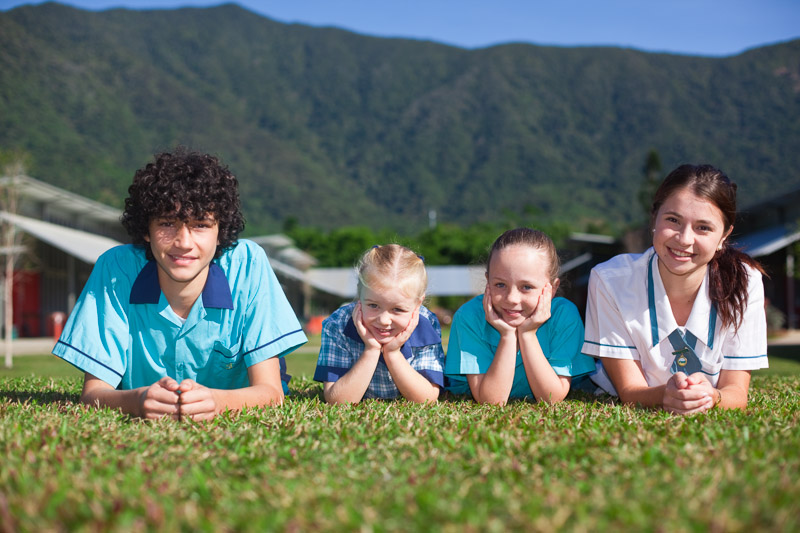 Portrait of older students with school's youngest students, Cairns