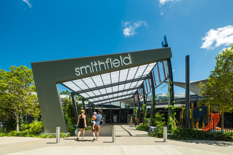 Family at entrance to the Smithfield Shopping Centre Entertainment Leisure Precinct in Cairns