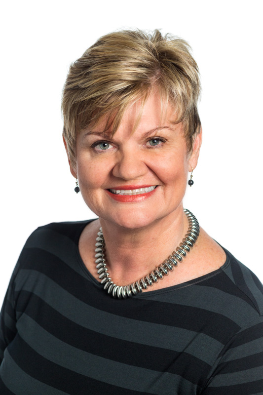 Corporate headshot of female Cairns real estate manager with white background