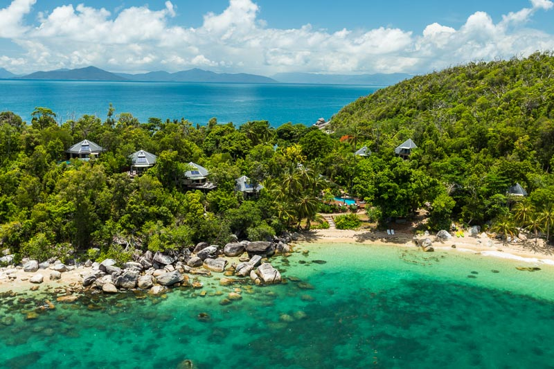Aerial view of holiday villas in rainforest hillside at Bedarra Island
