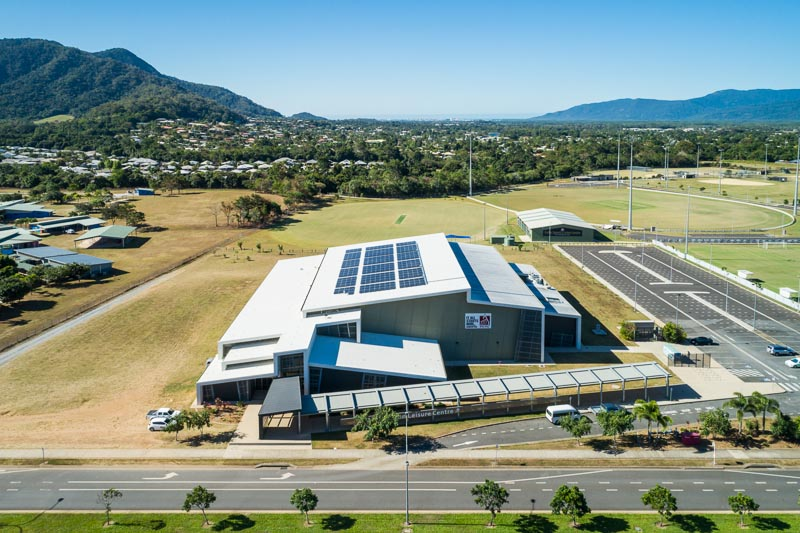 Aerial view of solar panels on commercial building, Cairns