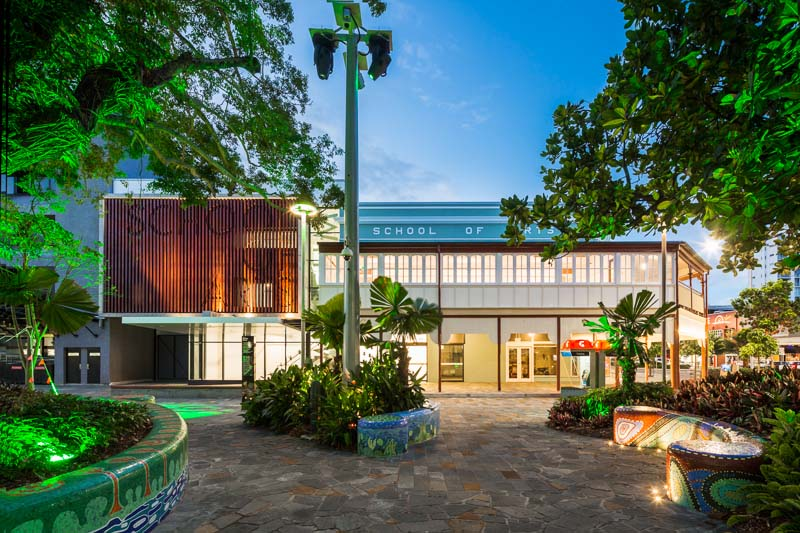 Front facade of School of Arts building illuminated at twilight, Cairns
