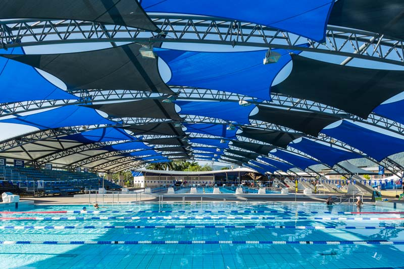 Public swimming pool covered by shade sails, Cairns