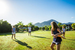 A young family having fun playing frisbee in a park