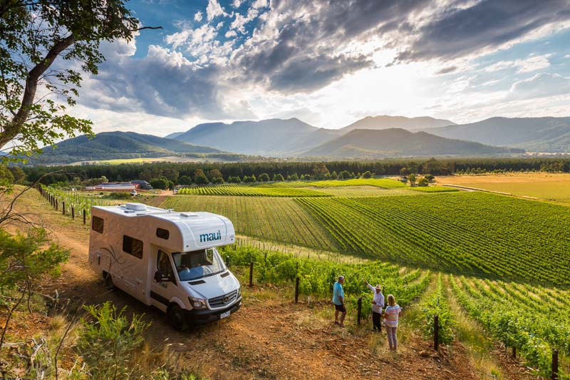 A couple with motorhome getting a tour of Feathertop Winery in Porepunkah, Victoria