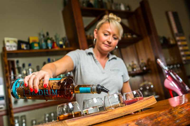 Waitress pouring rum for tasting at Mt Uncle Distillery, Walkamin