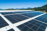 Solar panels installed on the roof of a commercial building in Cairns