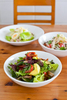 Three dishes of fresh salads at Mama Coco Cafe, Cairns