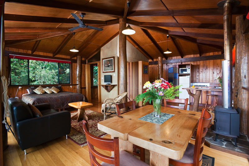 Dining and sleeping areas with a studio treehouse at Rose Gums Wilderness Retreat on the Atherton Tablelands