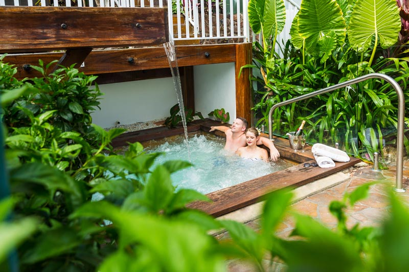Young couple relaxing in the spa at The Reef House Palm Cove in Cairns