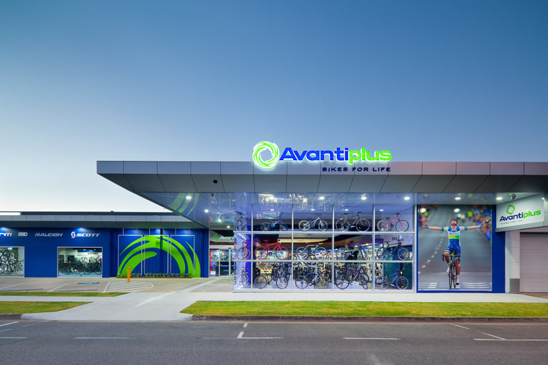 Exterior of the Avantiplus Store in Cairns illuminated at twilight