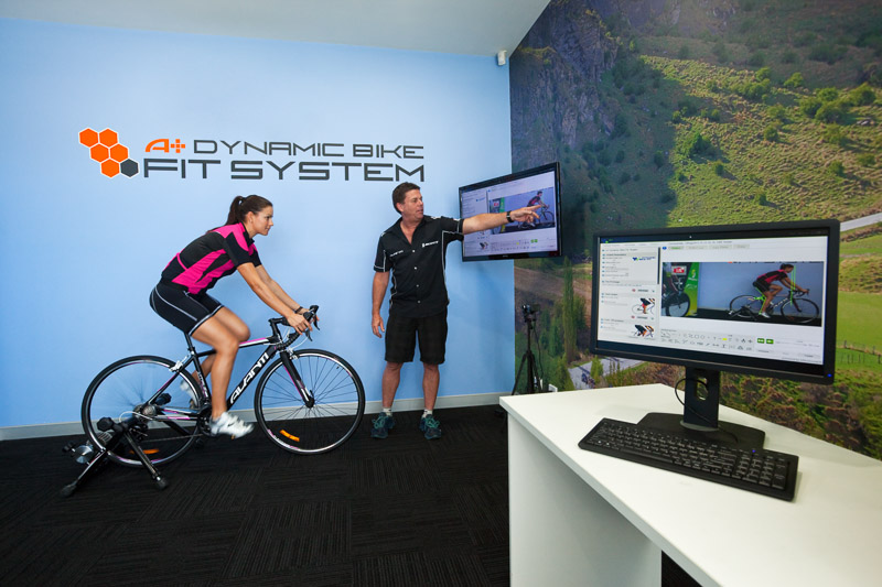 Cyclist getting her bike fitted using a technolody based system at Avantiplus store, Cairns