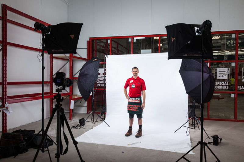 White backdrop and lighting setup for commercial portrait shoot at Bunnings Cairns