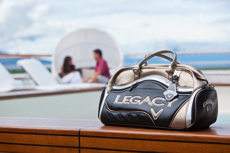 Callaway Legacy weekender bag on cruise liner with couple in background, Cairns