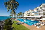 Pool and accommodation on the waterfront at Coral Sea Resort in Airlie Beach