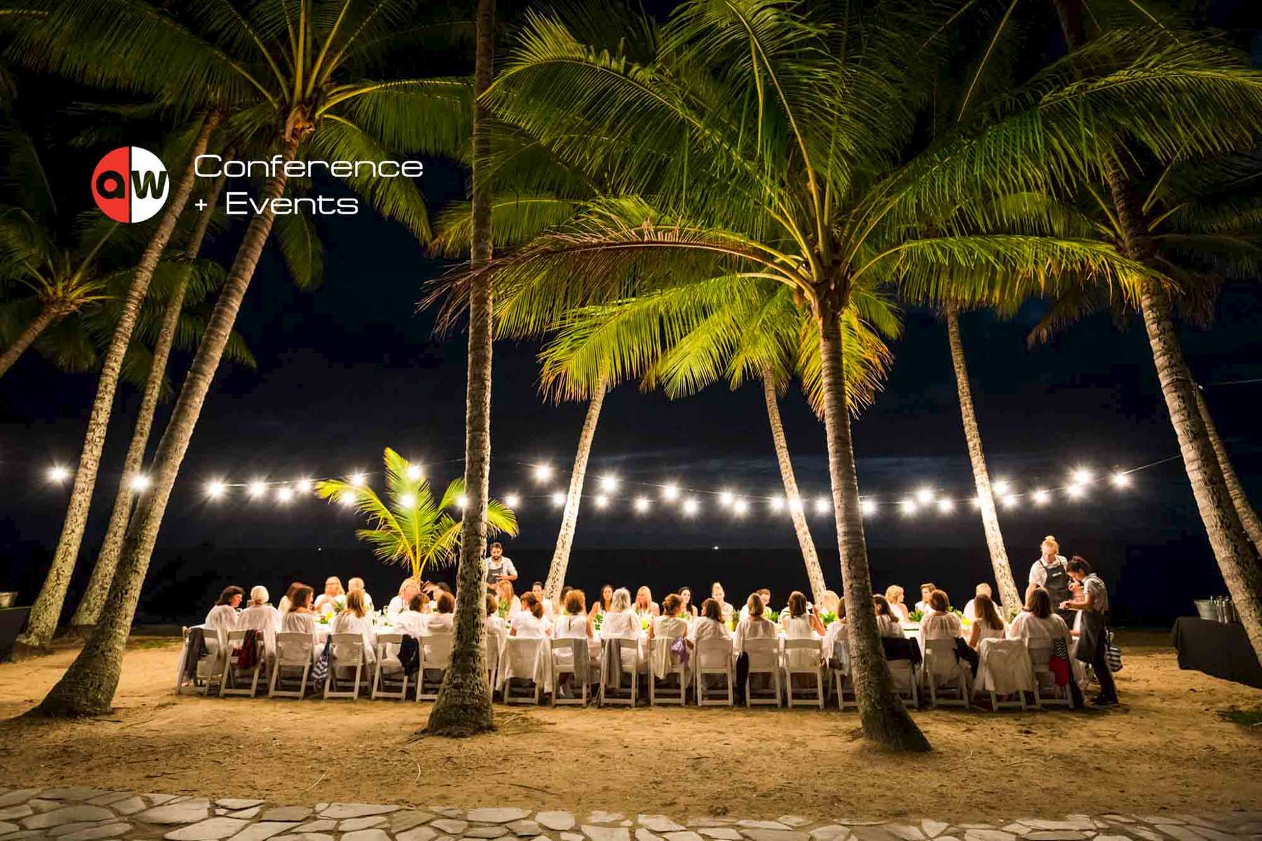 Guests eating outdoors under palm trees at Palm Cove, near Cairns - event photographer Cairns