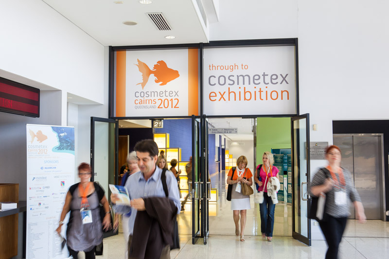 Delegates walking through entrance to Cosmetex 2012 Conference trade exhibit, Cairns