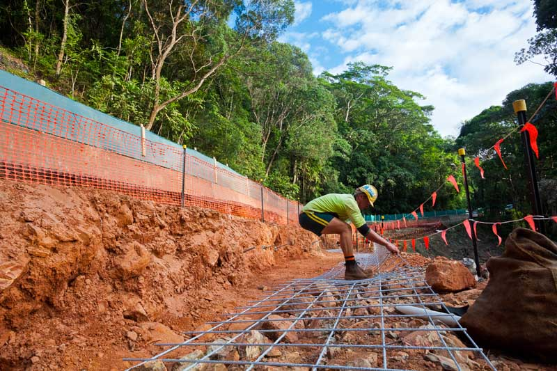 A worker lays re-inforcement steel for a slope stabilization project, near Cairns