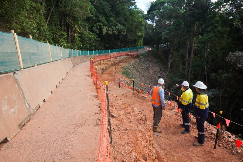 Constrcution workers standing on a section of highway undergoing slope stabilization works, Cairns