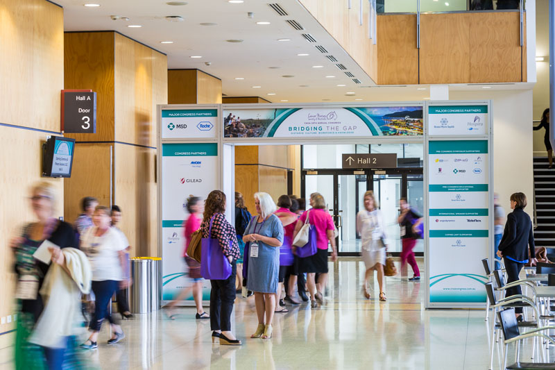 Delegates walking through trade exhibit entry at Cancer Nurses Society of Australia 19th Annual Congress in Cairns