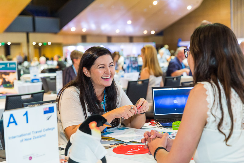 Delegates engaged in business meetings at the ANZA Workshop in Cairns